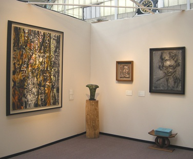 Left to right: Bryan Wynter, William Turnbull (on log), Leon Kossoff, Frank Auerbach, Lynn Chadwick, Lucie Rie (on table).